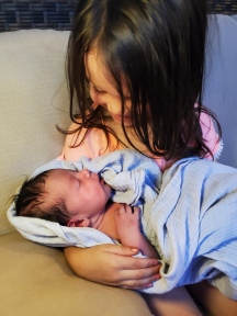Lydia holding Hannah